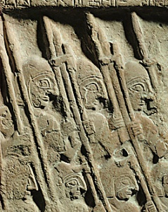 A portion of the Stele of Vultures, a Sumerian carving depicting a class between two Mesopotamian city states, circa 2500 BCE. This is regarded as history's first depiction of military action. It is also evidence that the Sumerians maintained organized professional armies -- another first.