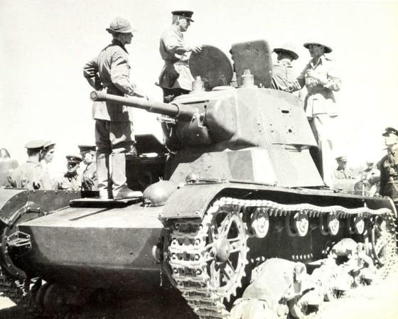 British troops examine a Soviet tank in Iran -- September, 1941.