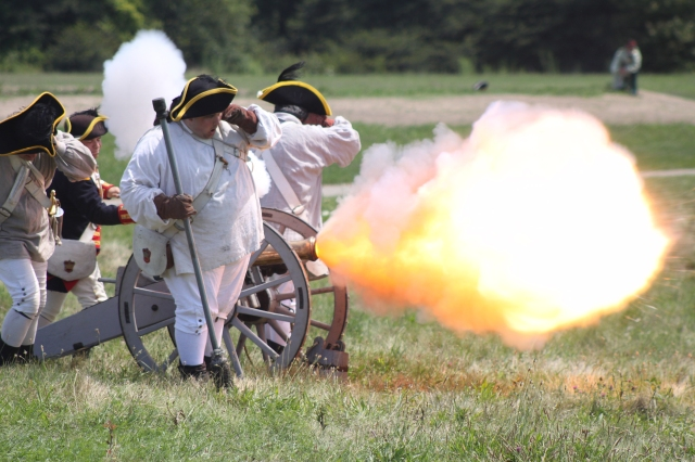 Reenactors demonstrate the firing of a British 3-pounder at Fort George, Niagara-on-the-Lake, Canada.
