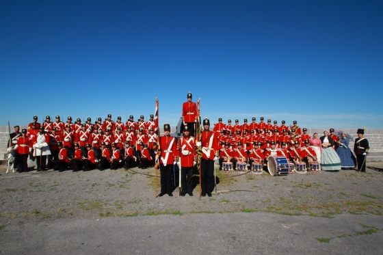 The Fort Henry Guard consists of the 28-member Drill Squad, 28-member Fort Henry Drums; 3 domestic interpreters, the Pioneer of the Garrison; the Artillery Lieutenant & Artillery Serjeant; the flag-bearing ensigns;  the Goat Major & mascot David X; and Captain Ben Campbell, Commandant of the Guard.
